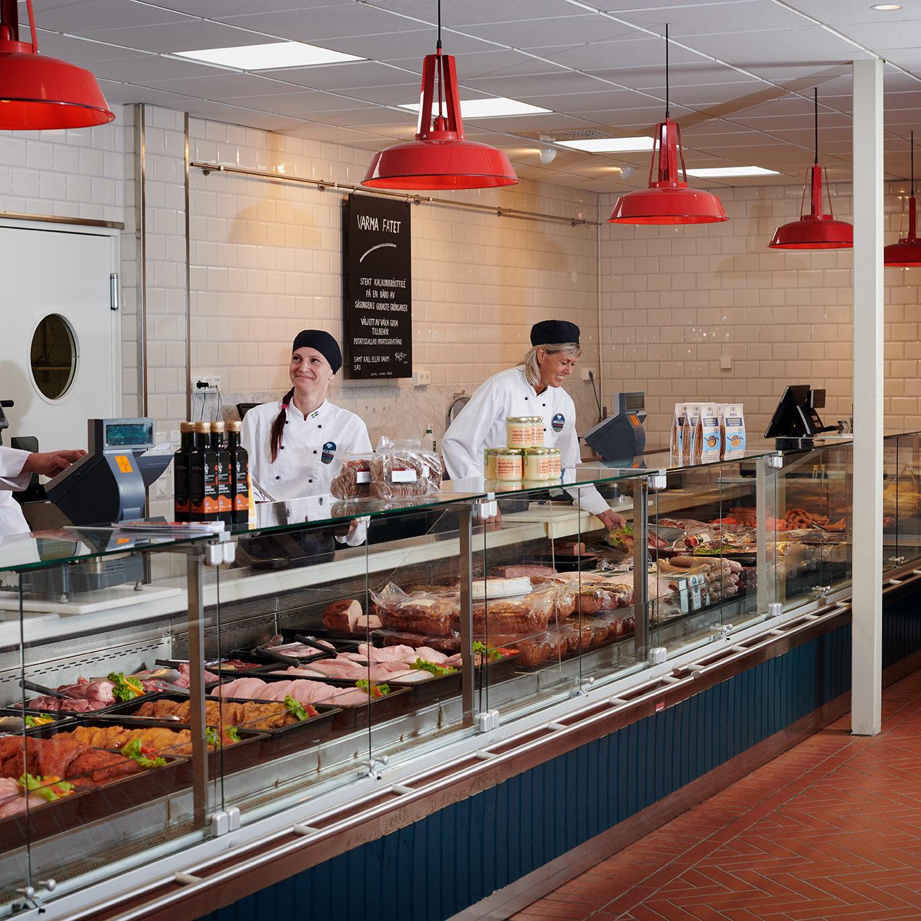 Jesper, Liv and Marita in the deli counter.